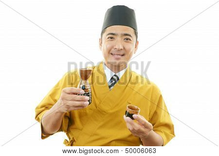 Portrait of an Asian waiter