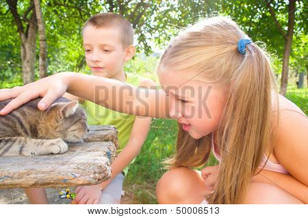 Children Play With Cat