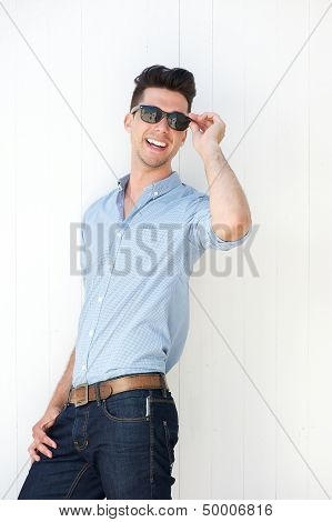 Happy Young Man With Sunglasses Laughing