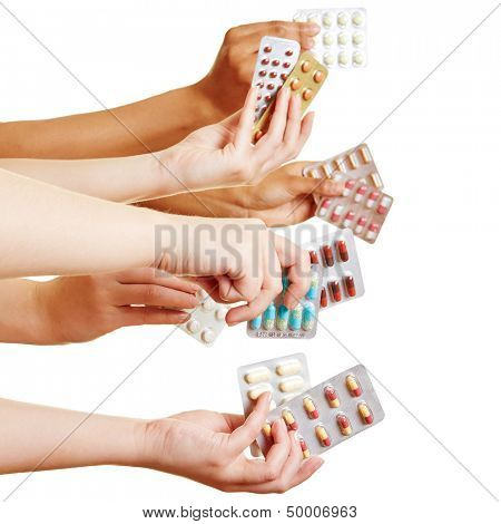 Many hands holding different drugs and pills