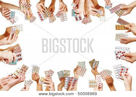 Frame of many hands with different colorful medical pills