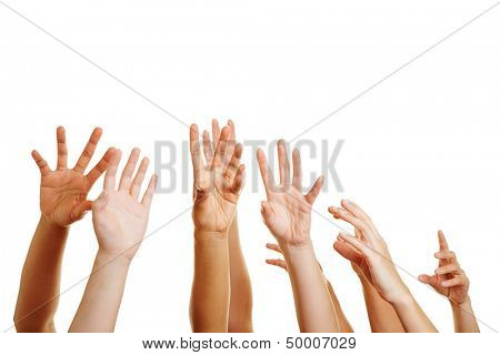 Many desperate hands reaching up into the air