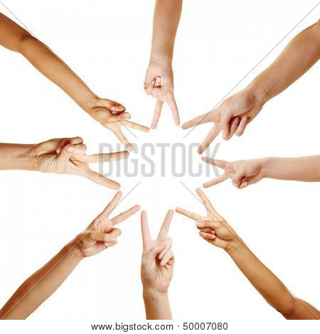 Many hands forming a star shape with their fingers