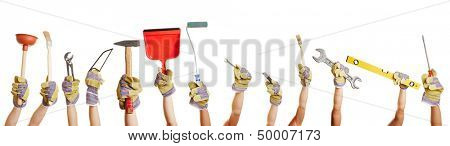 Many hands holding different tools for working and fixing things