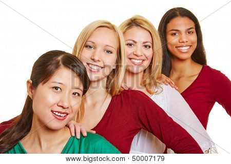 Group of four happy women standing in a row