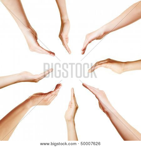 Many open hands in a circle pointing to the center