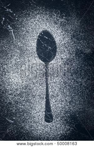 Kitchen spoon imprint made with icing sugar