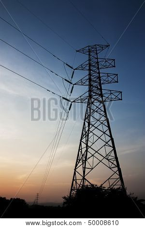 Silhouette Electric Pole On Sunset Background