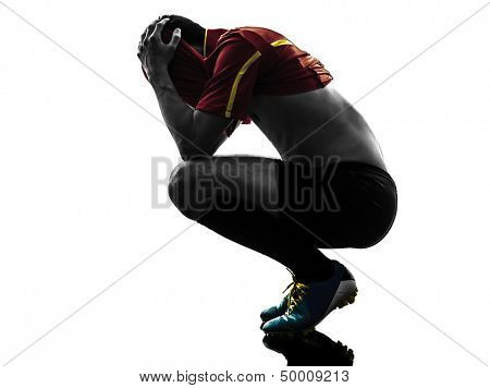 one man soccer player  loosing despair playing football competition in silhouette  on white background