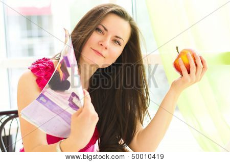 Young Woman With Magazine