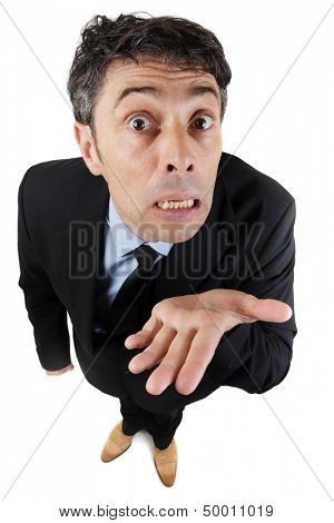 Needy business man begging, pleading his cause or showing his ignorance holding out the empty palm of his hand while looking expressively up at the camera isolated on white