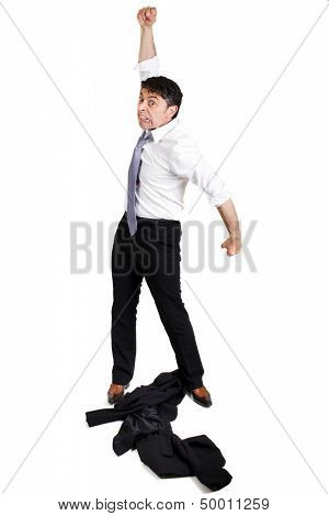 Mature businessman throwing his jacket down on the floor in frustration and anger and raising his fist in the air belligerently isolated on white