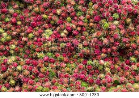 Rambutan fruit background in asian street market