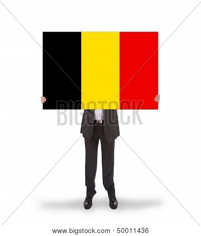Smiling Businessman Holding A Big Card, Flag Of Belgium