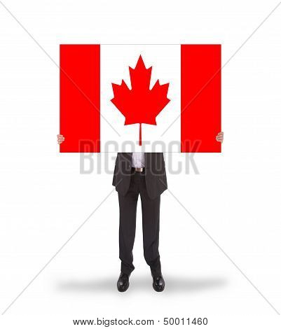 Smiling Businessman Holding A Big Card, Flag Of Canada