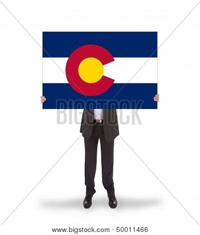 Smiling Businessman Holding A Big Card, Flag Of Colorado