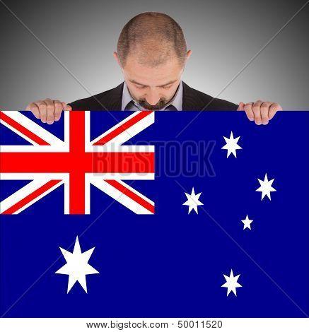 Smiling Businessman Holding A Big Card, Flag Of Australia