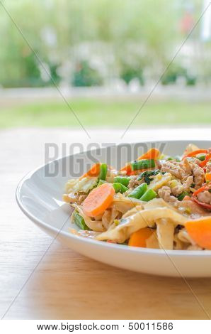 Stir-fried Flat Rice Noodles With Pork, Basil And Cow-pea