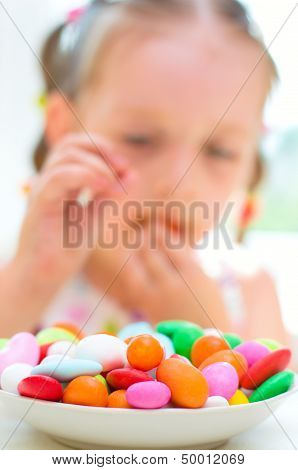 Girl Eating Candies