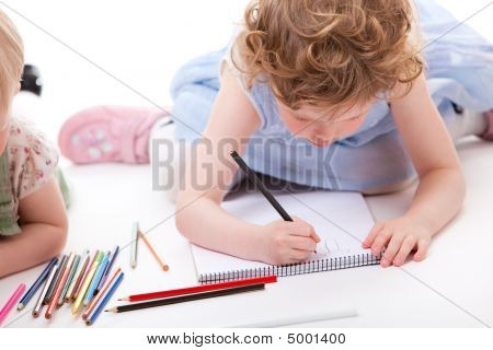 Little girl drawing with pencils. Isolated on white. poster