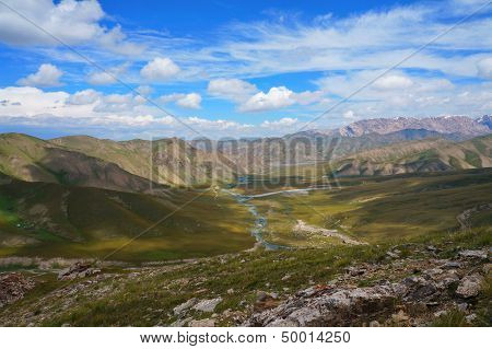 Small mountains, the river and amazing  blue sky with white clouds