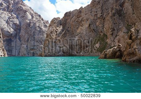 marvellous rocks and extraordinary Kelsu mountain lake against the background of colourful dark blue