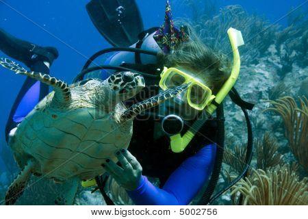 Female Scuba Diver With Sea Turtle