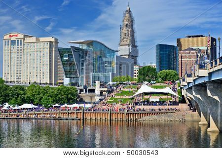HARTFORD - AUGUST 17: Crowds at the annual Riverfront Dragon Boat & Asian Festival August 17, 2013 in Hartford, CT. The event features boat racing and food stands.