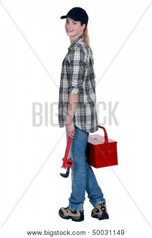 craftswoman holding a tool box and a spanner
