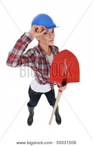 Craftswoman holding a shovel