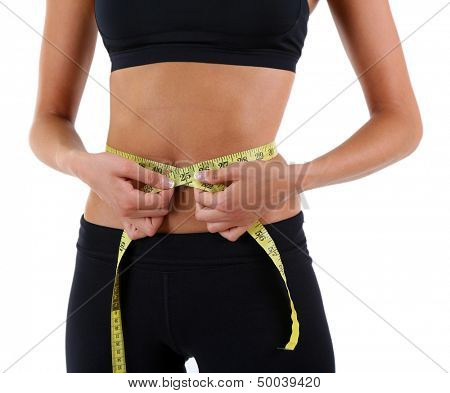 Slim girl with centimeter isolated on white