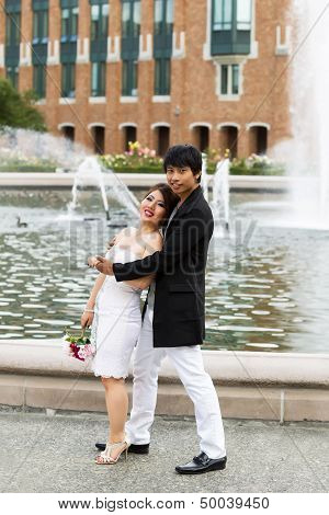 Young Couple Enjoying Each Other At The Water Fountain