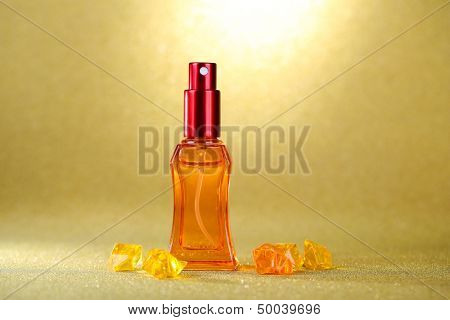 Women perfume in beautiful bottle on orange background