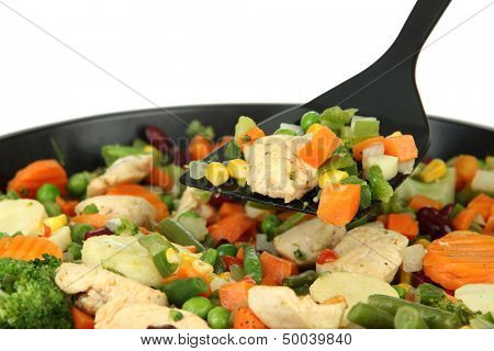 Casserole with vegetables and meat on pan, isolated on white
