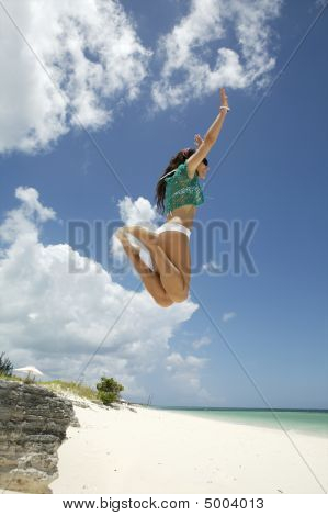 Woman Jumping In A Paradisiac Beach