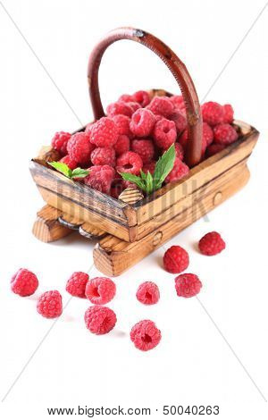 Ripe sweet raspberries in wooden basket, isolated on white