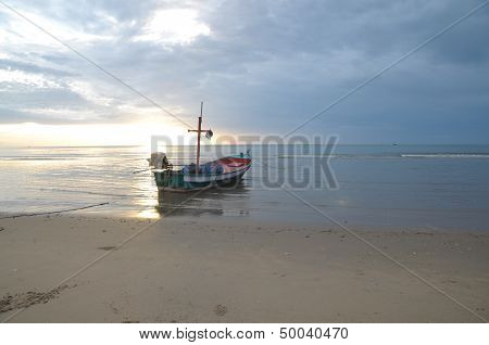 Fishing Boat On The Shore At Low Tide.