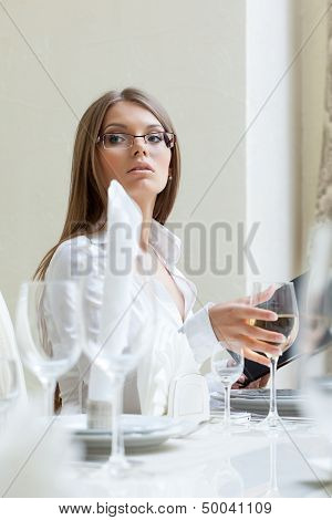 Serious business lady posing in restaurant