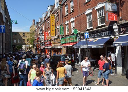 Tourists In Brick Lane, London Uk