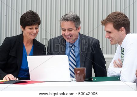 Happy Business Team At Office