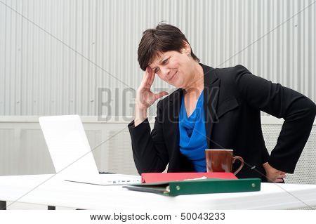 Businesswoman Under Stress, Fatigue, And Headache