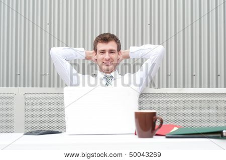 Portrait Of A Handsome Young Businessman Relaxing