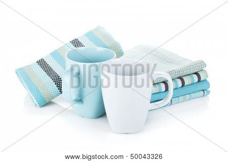 Kitchen towels and tea cups. Isolated on white background