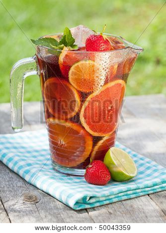 Refreshing fruit sangria (punch) on wood table