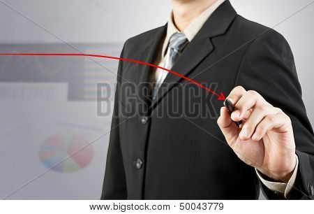 Businessman Hand Drawing Red Down Arrow