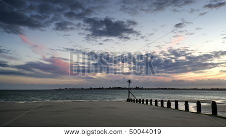 Beautiful Landscape Summer Sunset Sky Reflected On Wet Beach At Low Tide