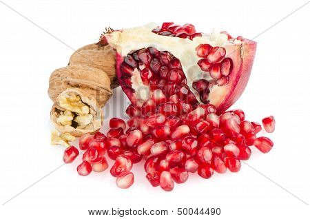 Half Pomegranate Fruit and Walnuts