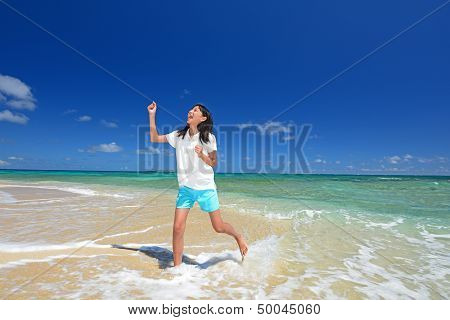 Smiling girl on the beach enjoy sunlight