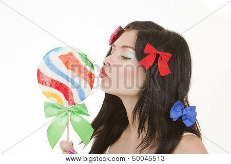 pinup retro woman kissing lollipop