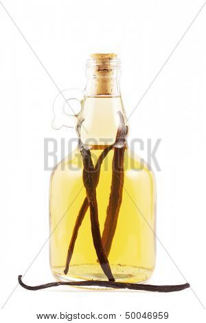 Bottle with vanilla liqueur or essence on white